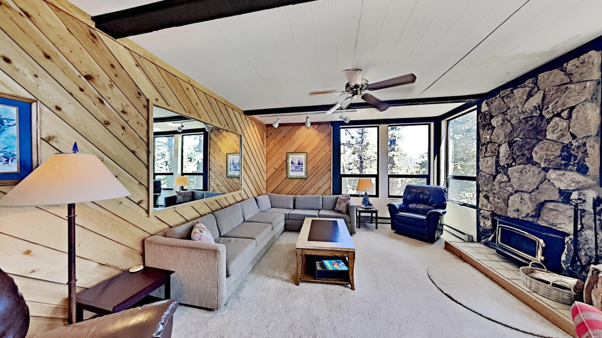 Cozy Living Room Overlooking A Forested Area