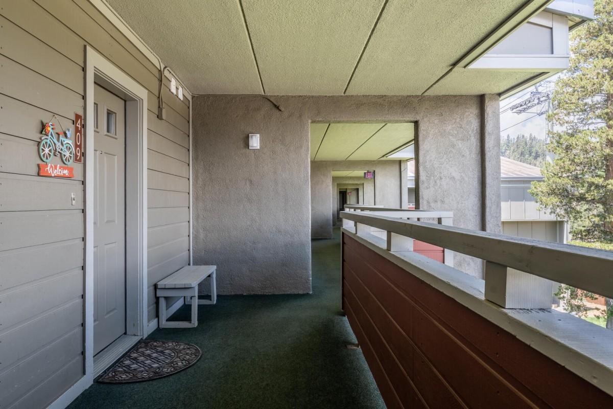 View of Front Door and Hallway to Elevator