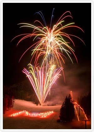 """Night of Lights celebration in Mammoth Lakes California with candles on the snow in the shape of an """"M"""""""