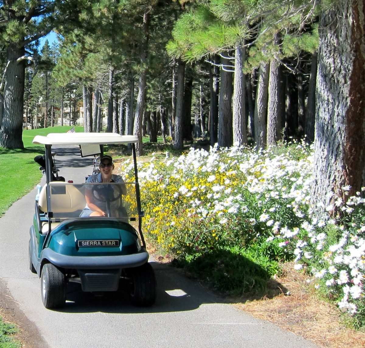 Woman on golf cart at the Sierra Star Golf Course