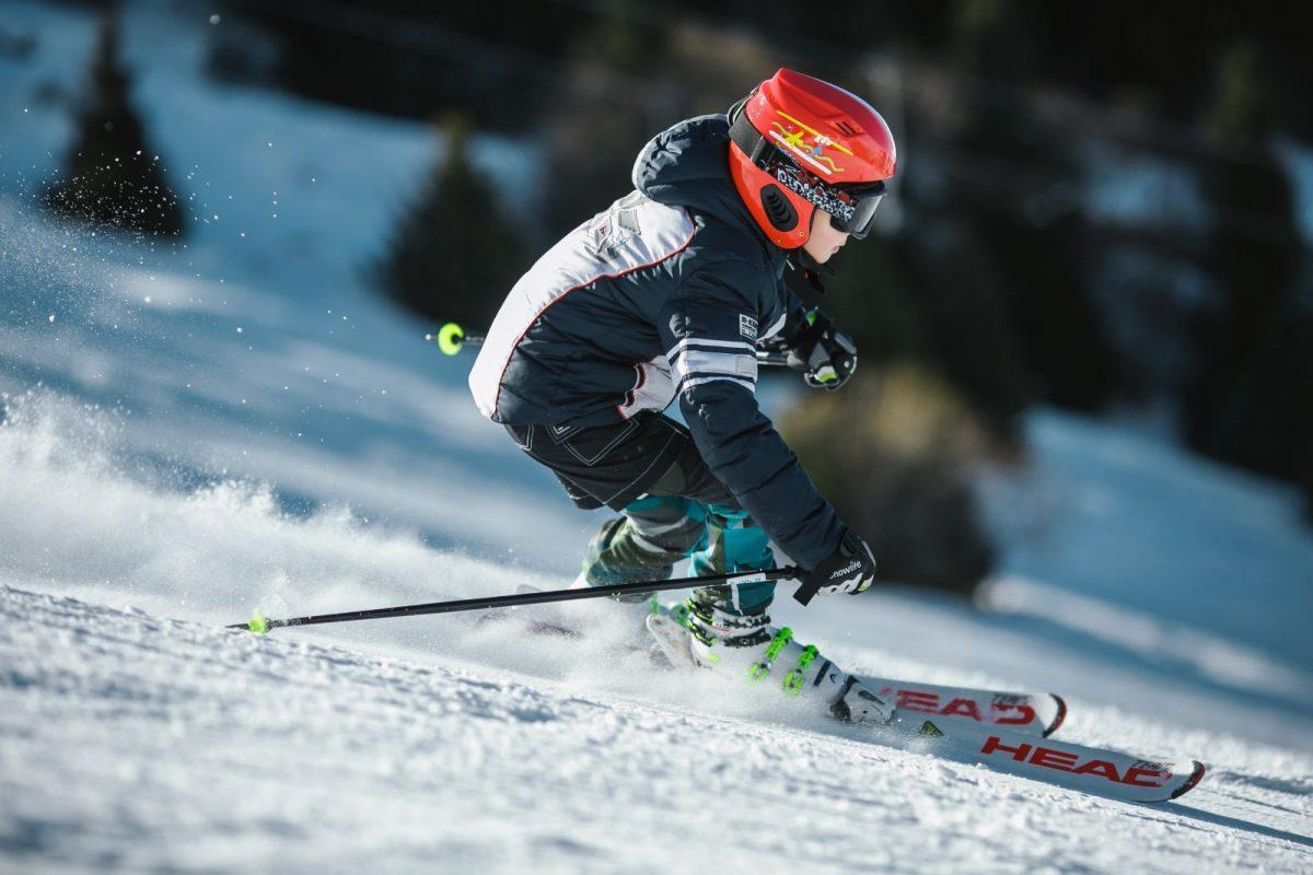 boy skiing down a mountain