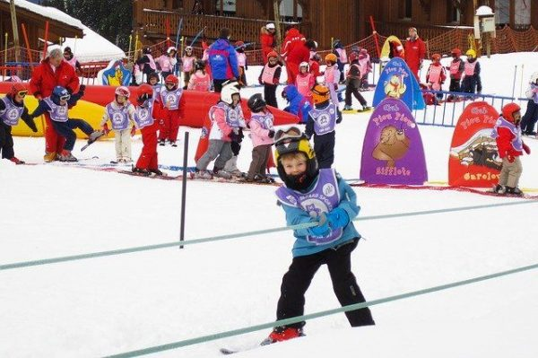 child practicing skiing