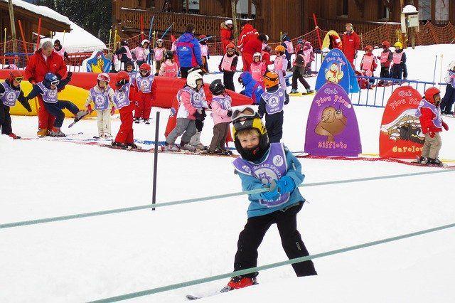 ski school kid skiing