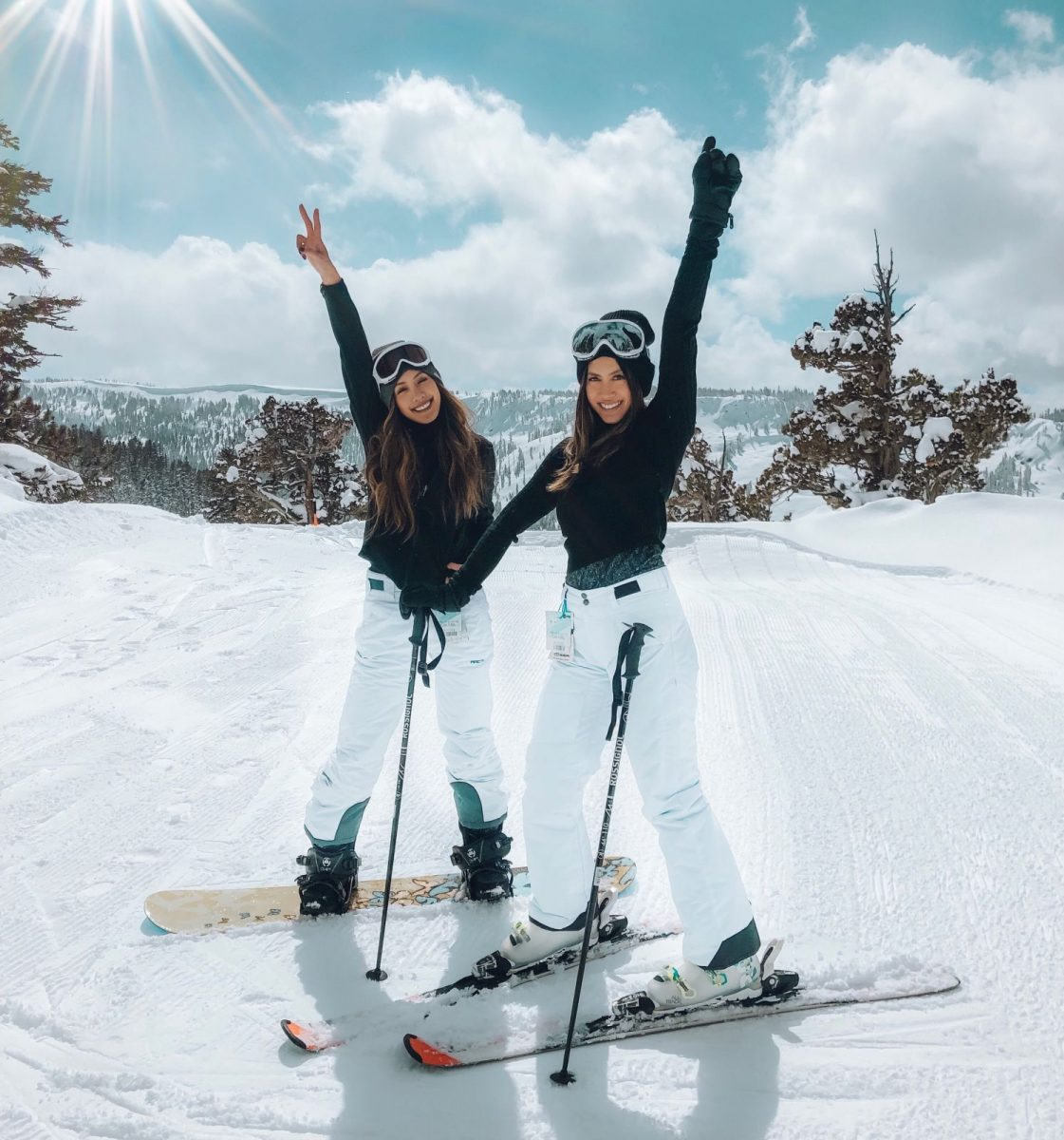women skiing and snowboarding