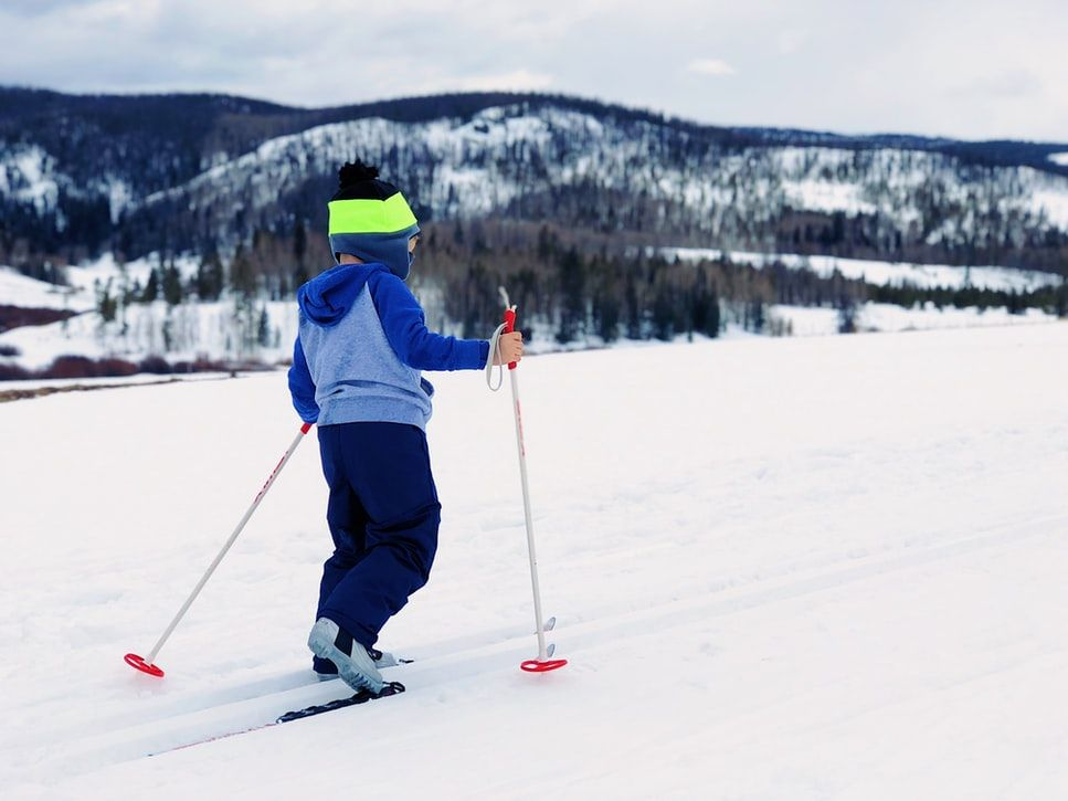 child on cross country skis