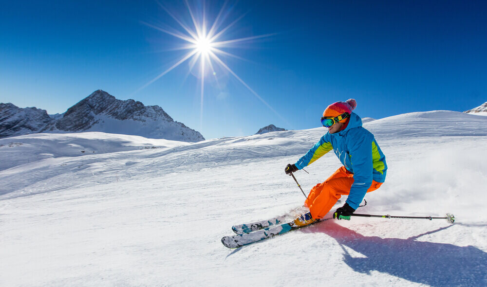 Photo of a person skiing on mountainside with the best skiing in California